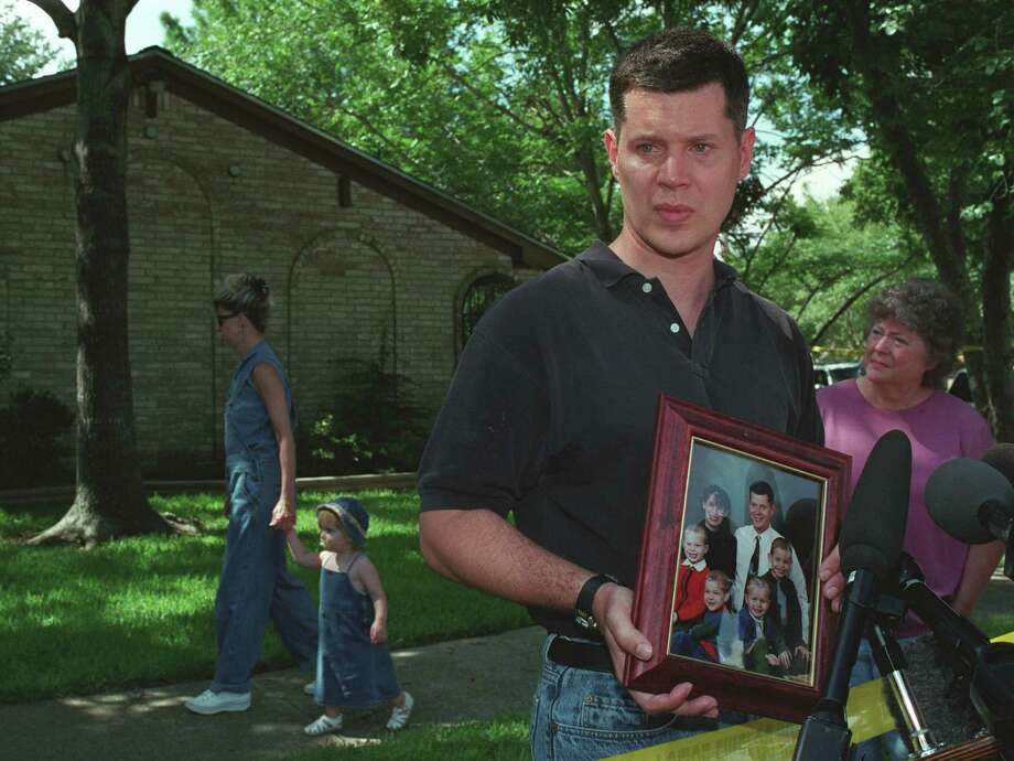 Russell Yates, husband of accused murderer Andrea Yates and father of their 5 dead children, came out front of his home in the Houston suburb of Clear Lake on Thursday June 21, 2001, and showed a family portrait taken last November, when his wife was about 8 months pregnant with their daughter.  Photo: Steve Ueckert, Houston Chronicle / Houston Chronicle