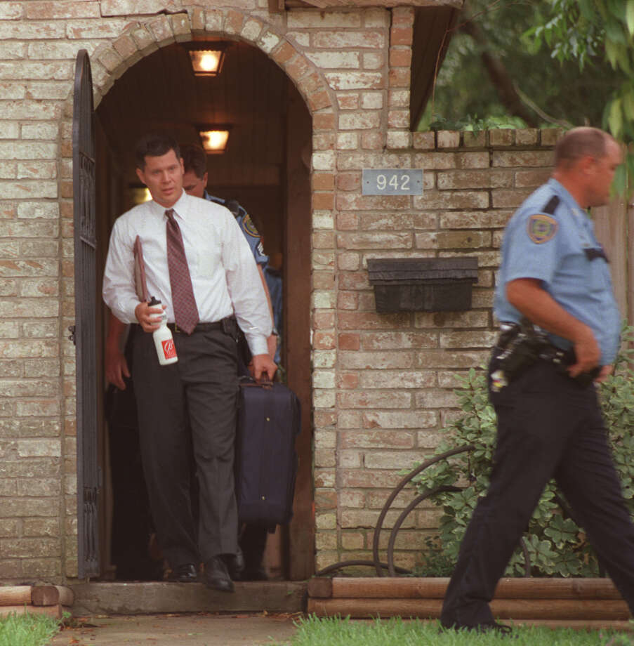 6/20/01--Russell E.Yates,the father of the five children who were killed in their Clear Lake City home,is escorted to his car by police after collecting a few items at home.  Police had been talking to him at a neighbor's house before he went home to collect the items.  His wife, Andrea Yates, (the children's mother) was arrested Wednesday on suspicion of drowning her five children, ages 6 months to 7 years, in the bathtub. The father is not believed to be involved in the deaths.     HOUCHRON CAPTION (01/07/2005) SECNEWS:  HUSBAND:  Rusty Yates leaves his Clear Lake home with a few belongings in June 2001, a few hours after his wife killed their five children.  He has since filed for divorce. Photo: Karen Warren, Houston Chronicle / Houston Chronicle
