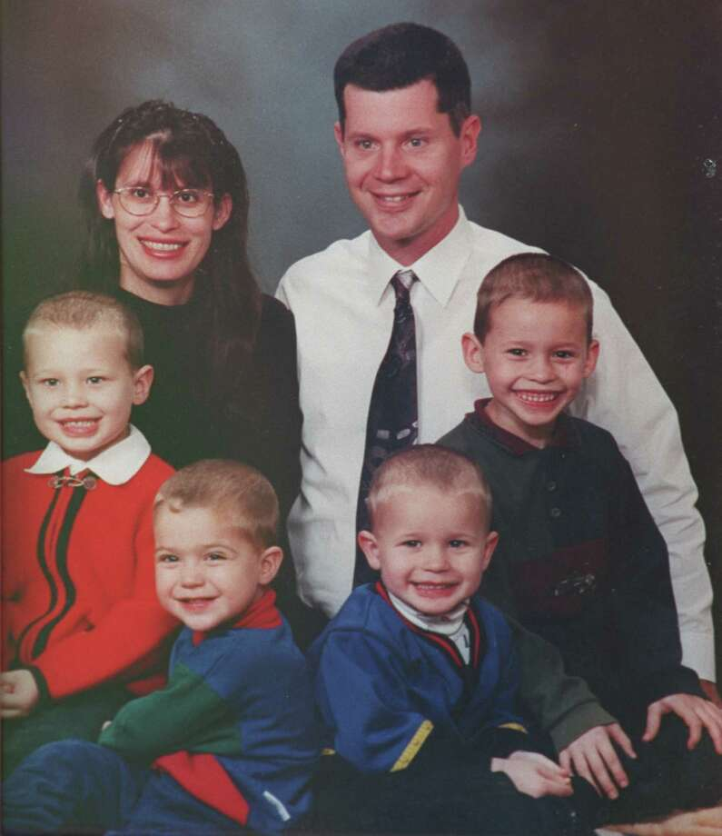 Andrea Pia Yates and her husband, Russell, are shown in a family photo with their four boys, from left, John, Luke, Paul, and Noah.  Photo: Steve Ueckert, Family Photo / handout