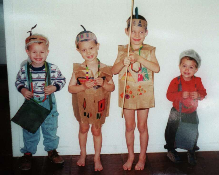 The oldest four of the five Yates children -- Paul, John, Noah and Luke -- in a photo dated October 2000.  Photo: Steve Ueckert, Photo Provided By Family / handout