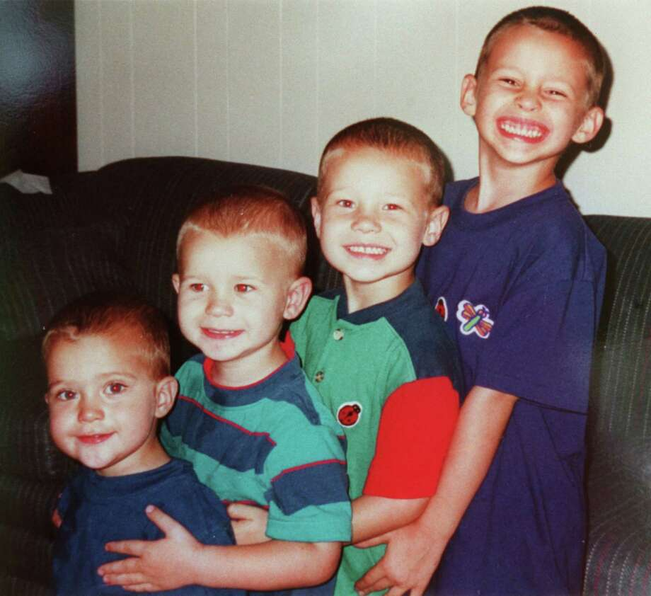 In an undated photo, provided by Yates, are his sons, (L to R) Luke, Paul, John and Noah. Photo: Steve Ueckert, Family Photo / Handout