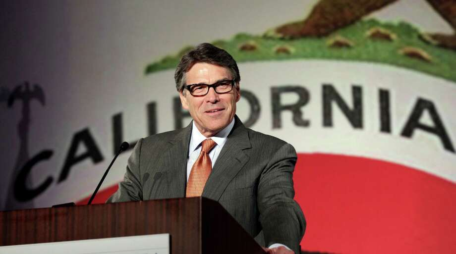 "FILE - In this Oct. 5, 2013 file photo Texas Gov. Rick Perry gives the keynote speech at the California Republican Party convention in Anaheim, Calif. California Gov. The Republican has made convincing top employers elsewhere to move to Texas a centerpiece of his administration. California has been a prime target, with Perry bashing what he calls the Golden State's high-tax, over-regulated ways. But a New York Times Magazine story released Tuesday says Perry told the reporter ""he loves California"" and ""might even move"" there in January, when his term ends. Photo: Reed Saxon, AP / AP"