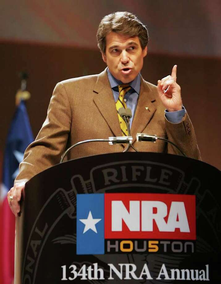 Texas Gov. Rick Perry addresses the 134th National Rifle Association Convention, April 15, 2005, in Houston.  Photo: DAVID J. PHILLIP, AP / AP