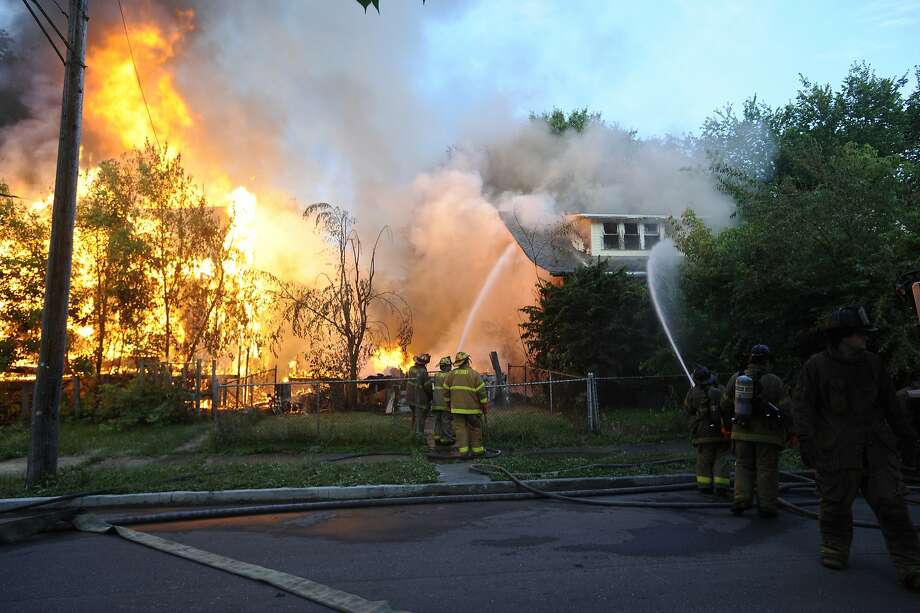 Vacant houses apparently torched: Firefighters try to put out a fire at an abandoned house on the east side of Detroit. The blaze, which destroyed 