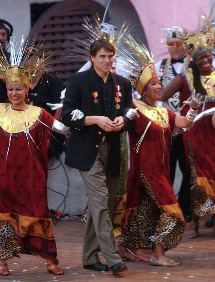 Grand Marshal Gov. Rick Perry arrives at the Texas Cavalier River Parade, April 22, 2002, in San Antonio. Photo: BILLY CALZADA, SAN ANTONIO EXPRESS-NEWS / SAN ANTONIO EXPRESS-NEWS
