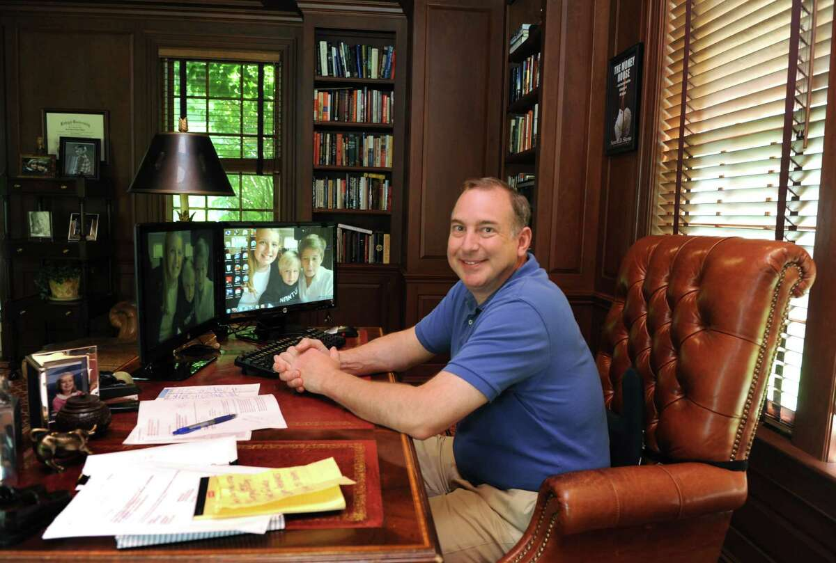 """Financial expert and New Canaan resident Scott E.D. Skyrm, who has just written the book """"Rogue Traders"""", detailing a handful of high-profile mistakes and scams on Wall Street, is photographed at home in his office on Friday June 20, 2014."""