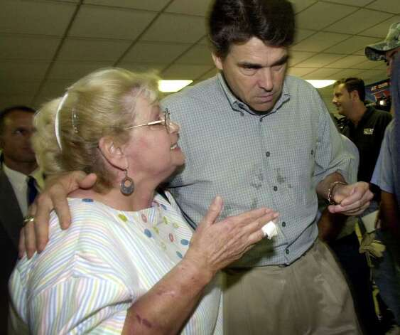 Gov. Rick Perry left talks with Connie Hunt during a visit to an emergency shelter in Port Lavaca, July 17, 2003. Hunt was seeking assistance for those affected by Hurricane Claudette. Photo: ERIC GAY, AP / AP