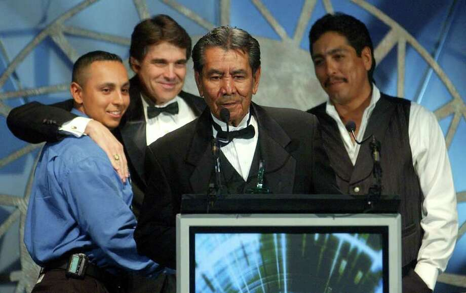 "Isidro ""El Indio"" Lopez, known as the father of Tejano music, speaks April 13, 2002, at the Alamodome in San Antonio after receiving the Tejano Music Awards Lifetime Achievement Award from Texas Gov. Rick Perry. Lopez accepted the award with his sons Javier (left) and Isidro, Jr. Photo: WILLIAM LUTHER, SAN ANTONIO EXPRESS-NEWS / SAN ANTONIO EXPRESS-NEWS"