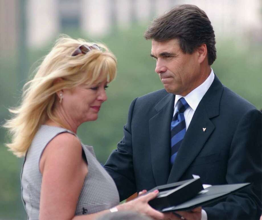 Marsha Cottle accepts a medal and resolution presented by Texas Gov. Rick Perry during the Texas Peace Officer's Memorial Service, May 5, 2003, in Austin. Her husband, Senior Trooper Richard Dale Cottle, a member of the Texas Department of Public Safety, was killed in the line of duty on May 9, 2001. Photo: HARRY CABLUCK, AP / AP