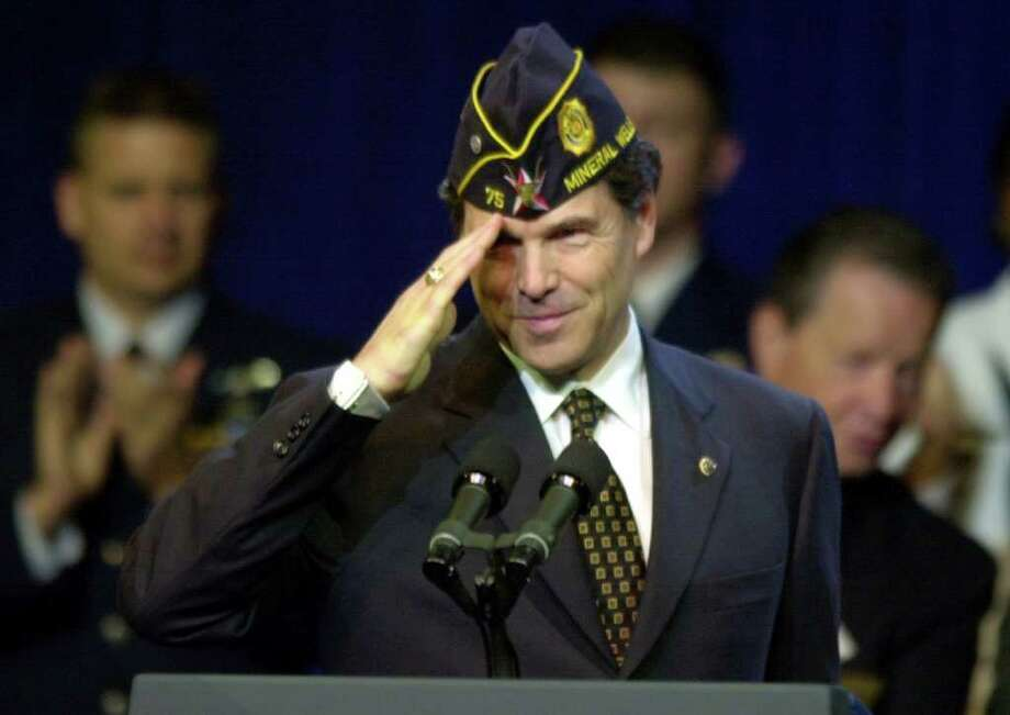 Texas Governor Rick Perry salutes fellow American Legion members, Aug. 29, 2001, before addressing the Legion's national convention. Photo: BAHRAM MARK SOBHANI, SAN ANTONIO EXPRESS-NEWS