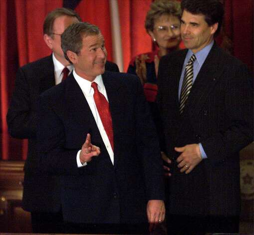 "Gov. George W. Bush flashes the ""W"" sign after his speech as Lt. Governor Rick Perry looks on. Photo: TOM REEL, SAN ANTONIO EXPRESS-NEWS / SAN ANTONIO EXPRESS-NEWS"