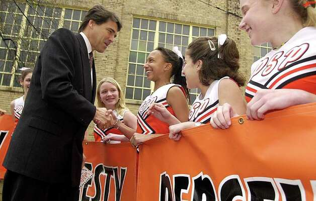 Texas Gov. Rick Perry greets Starr Riley at Pine Street Middle School in Texarkana, Feb. 15, 2001.  Perry was in Texarkana to discuss his goal of developing new math initiatives in public schools in Texas. Photo: GREG FELKINS, AP / TEXARKANA GAZETTE