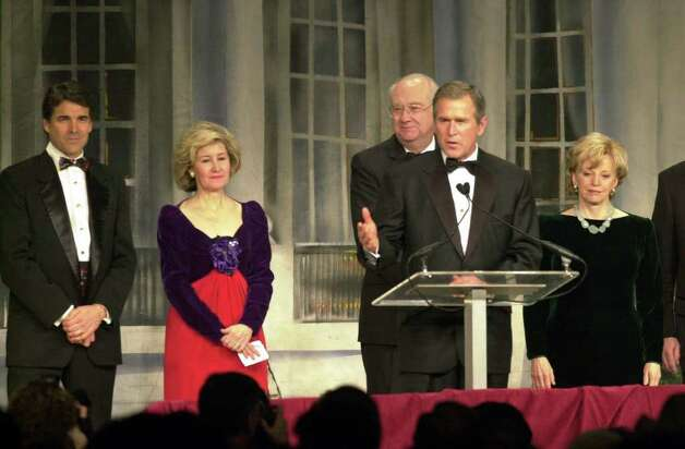 President-elect George W. Bush speaks during the Texas State Society Black Tie and Boots Ball, Jan. 19, 2001 in, Washington. Sharing the stage with him are Texas Gov. Rick Perry, Sen. Kay Bailey Hutchison R-Texas, Sen. Phil Gramm R-Texas and Lynn Chaney. Photo: EDWARD A. ORNELAS, EN / EN