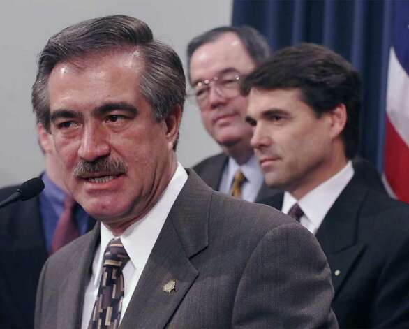 Patricio Martinez, governor of Chihuahua, Mexico, speaks during a news conference after meeting with Texas Gov. Rick Perry, Jan. 12, 2001, in Austin. In center is State Sen. David Sibley, R-Waco. Both governors spoke briefly after a private meeting. Photo: HARRY CABLUCK, AP / AP