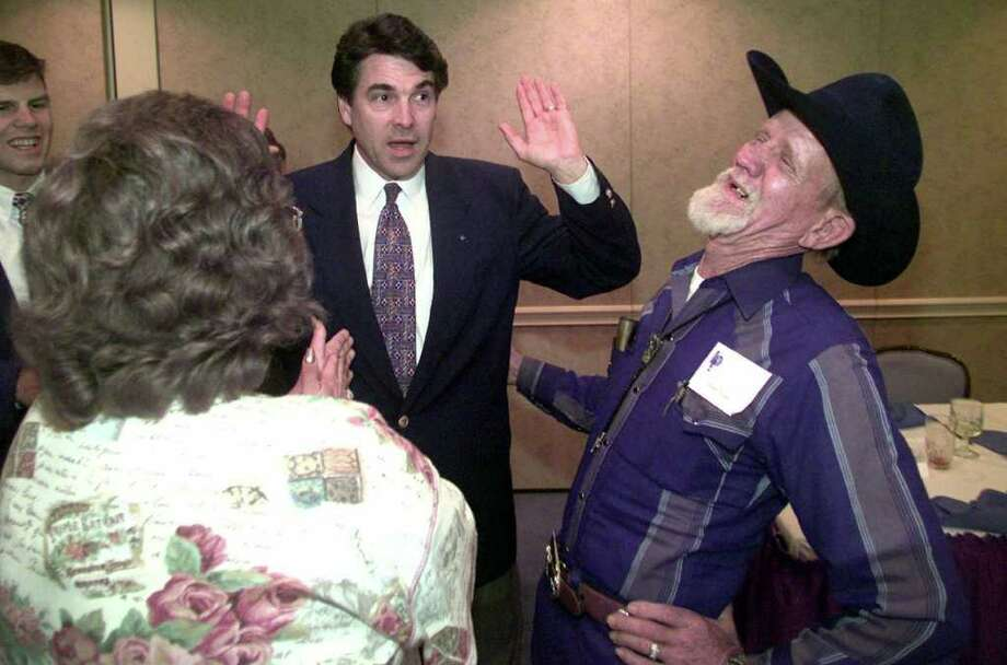 Collen Hilton (left) and Jimmy Hilton (right) respond to a humorus remark by Texas Lt. Gov. Rick Perry, while visiting with him after he spoke at the Longview Partnership's luncheon, Aug. 24, 2000, at Pinecrest Country Club in Longview. Photo: KEVIN GREEN, AP / LONGVIEW NEWS-JOURNAL