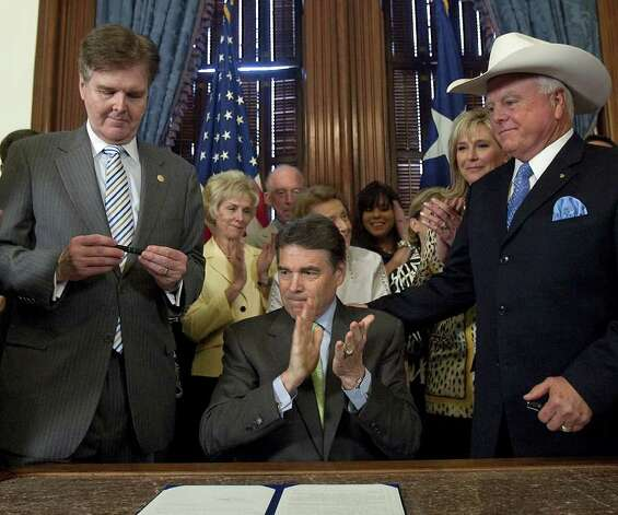 Texas Gov. Rick Perry begins to applaud after signing the sonogram bill flanked by bill sponsors Sen. Dan Patrick, R-Houston (left), Rep. Sid Miller, R-Stephenville, (right) and pro life supporters at the apitol in Austin, May 24, 2011. The sonogram bill requires that women considering an abortion an opportunity must first get a sonogram and wait 24 hours before having an abortion.  Photo: AP