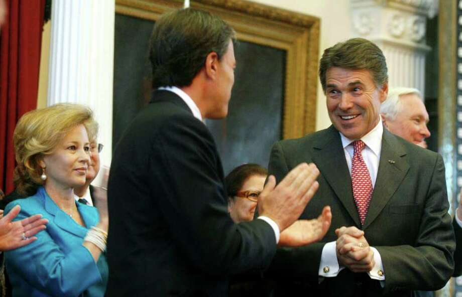 Gov. Rick Perry looks toward House Speaker House Joe Straus during the state of the state presentation to a joint session of the 82nd Legislature in Austin. The governor portrayed the budget shortfall as an opportunity to streamline state government. Photo: JACK PLUNKETT, ASSOCIATED PRESS