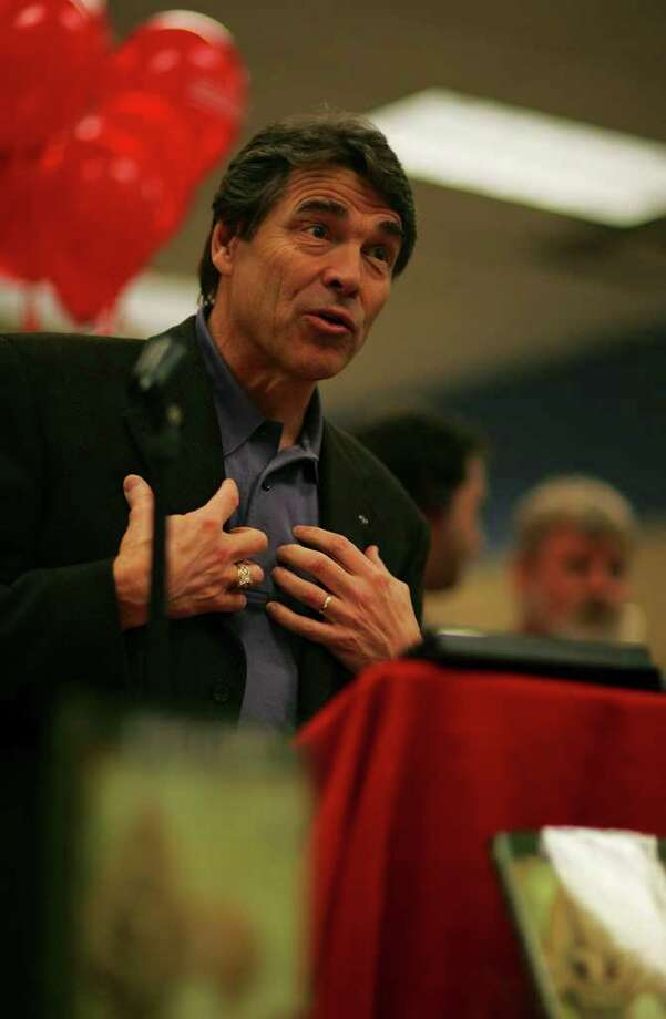 "Gov. Rick Perry promotes his new book, ""On My Honor: Why the American Values of the Boy Scouts are Worth Fighting For,"" Feb. 26, 2008, at Borders Books in San Antonio. Photo: BAHRAM MARK SOBHANI, SAN ANTONIO EXPRESS NEWS / SAN ANTONIO EXPRESS NEWS"