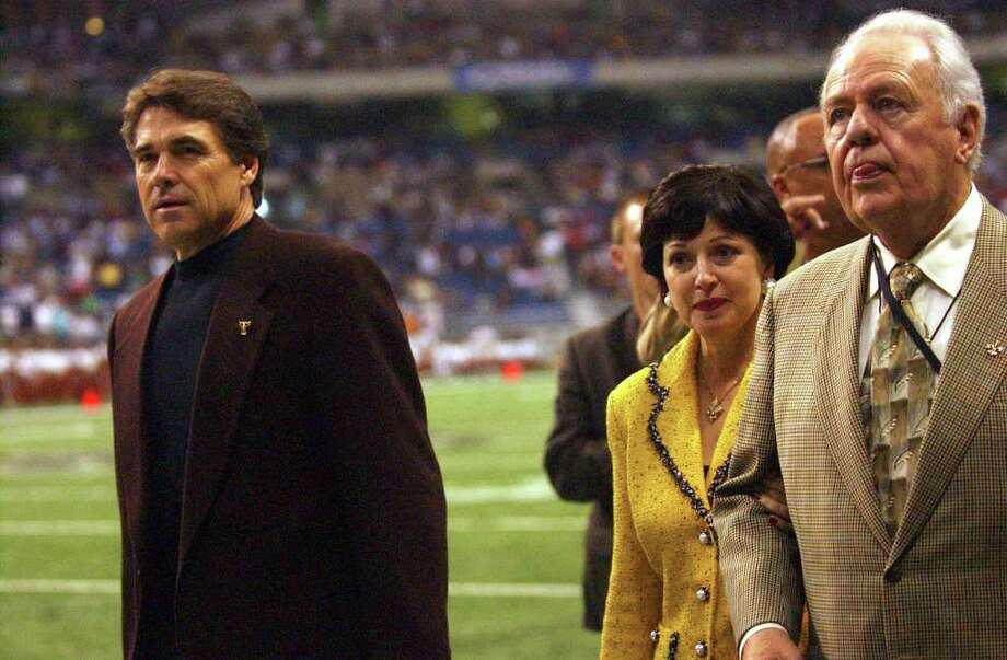 Gov. Rick Perry and New Orleans Saints owner Tom Benson leave the field after a pregame ceremony, Oct. 16, 2005, at the Alamodome. The Saints held some home games in San Antonio after Hurricane Katrina. Photo: GLORIA FERNIZ, SAN ANTONIO EXPRESS-NEWS / SAN ANTONIO EXPRESS-NEWS