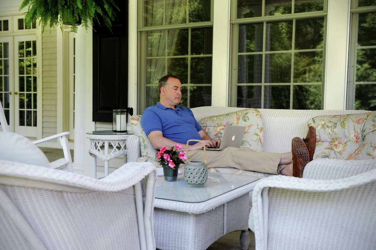 """Financial expert and New Canaan resident Scott E.D. Skyrm, who has just written the book """"Rogue Traders"""" detailing a handful of high-profile mistakes and scams on Wall Street, works outdoors on Friday June 20, 2014."""