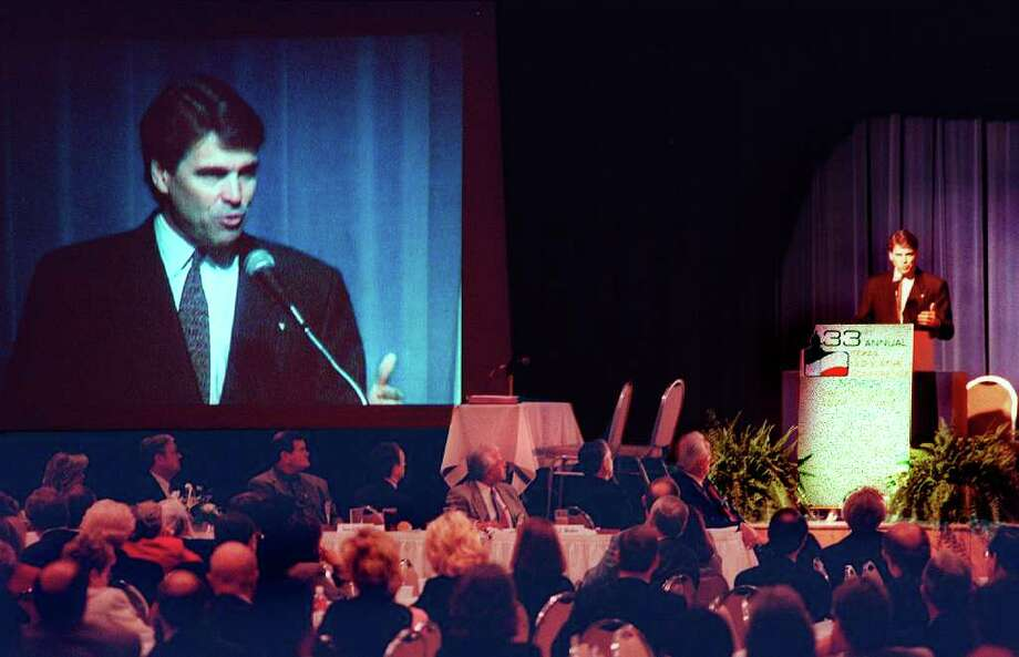 """Lt. Governor Rick Perry addresses the 33rd annual Texas Legislative Conference Friday, March 26, 1999, in New Braunfels' Civic Center.  The conference touched on various topics such as """"Ethics in Government,""""  """"Municipal Annexation,""""  and """"Spending the Budget Surplus.""""  Photo: JOEY GARCIA"""