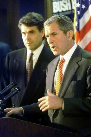 Speaking at a news conference following his formal signing of papers to enter the race for president,  George W. Bush talks about attempts to misrepresent his website with pornographic images.  Lt. Governor Rick Perry stood beside him through the appearance.