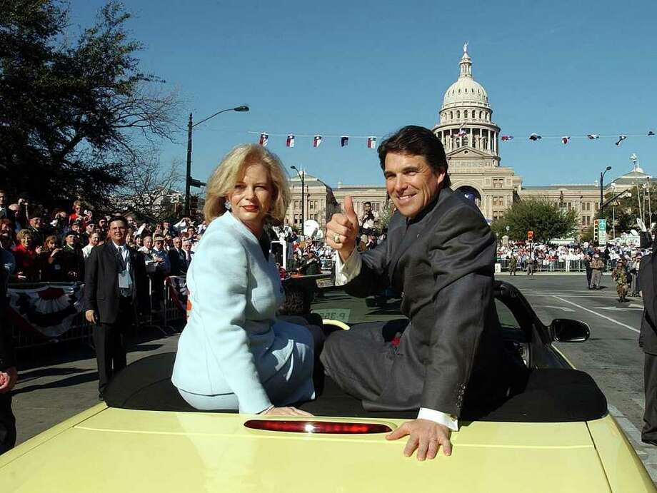 Gov. Rick Perry and his wife Anita arrive at the grandstand  during the Texas Inaugural Oath of Office Parade in front of the Texas State Capitol, Jan. 21, 2003.  Photo: JERRY LARA, SAN ANTONIO EXPRESS-NEWS / SAN ANTONIO EXPRESS-NEWS
