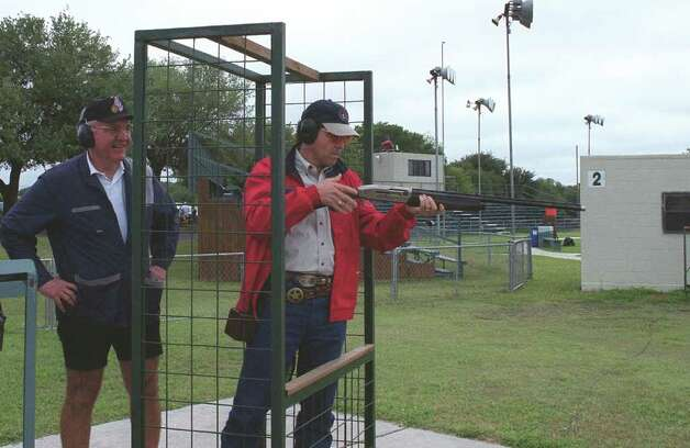 A little shooting coaching from Rocky Goodman prepares Lt. Gov. Rick Perry for a few clay targets at the Texas Shoot-Out at the National Shooting Complex in western Bexar County.  Photo: RALPH WININGHAM
