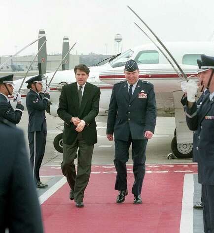 Lt. Gov. Rick Perry and Brig. Gen Paul Bielowicz walk under an arch of sabers following Perry's arrival at Kelly AFB, Jan. 29, 1999 in San Antonio. Photo: ROBERT MCLEROY