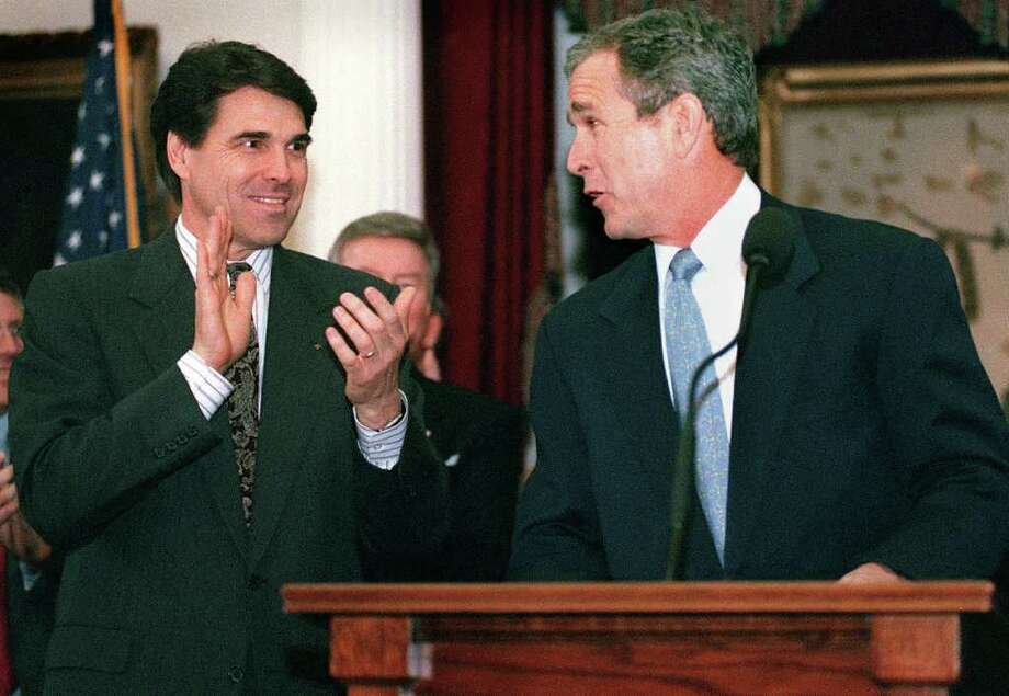 Gov. George W. Bush makes a reference to Rick Perry in his State of the State speech to the Legislature at the Capitol in Austin. Photo: Tom Reel