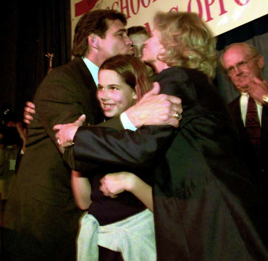 Rick Perry Republican candidate for Texas Lt. Gov. gets a kiss from wife Anita while hugging daughter Sydney, 12 with son Griffen, 15 behind them while at his campaign center at the Austin Convention Center, Nov. 03, 1998.