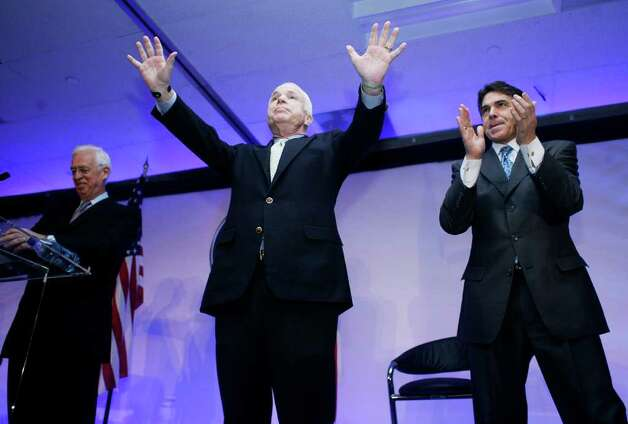 Presidential hopeful U.S. Senator John McCain (R-AZ) greets supporters at a town hall meeting with Dell Chief Financial Officer Don Carty and Texas Gov. Rick Perry at Dell headquarters in Round Rock, Texas,  Feb. 29, 2008. McCain was campaigning before the March 4 primary.  Photo: Ben Sklar, Getty Images / 2008 Getty Images