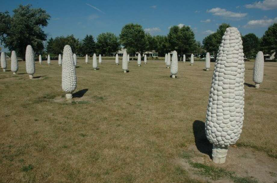 "9. ""Field of Giant Corn Ears,"" Dublin, Ohio. Nicknamed ""Cornhenge,"" the 109 concrete corn ears, some 6 to 8 feet tall, are actually part of a publicly funded work by Ohio State University sculpture teacher Malcolm Cochran, titled ""Field of Corn (with Osage Orange)."" The two-acre installation includes 13 diagonal rows of corn and two rows of Osage orange trees, one dating back to the 19th century, according to an article published on GreenMuseum.org. Photo: Web2jordan, Wikimedia"