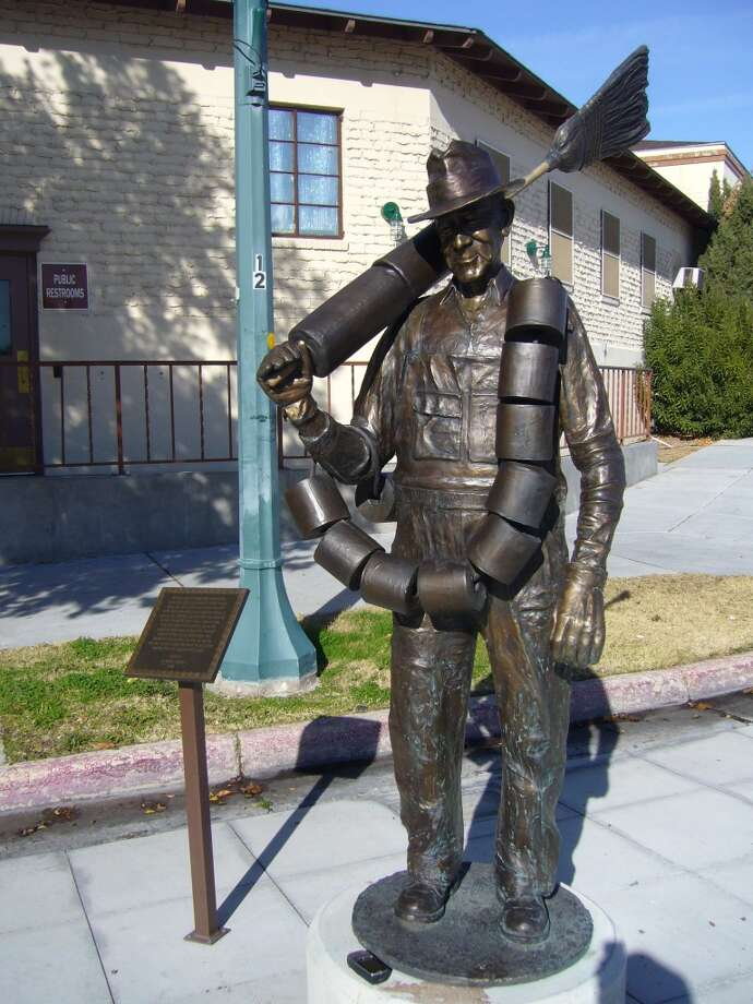 "1. ""Toilet Paper Hero of Hoover Dam,"" Boulder City, Nev. Steven Liguori's bronze sculpture of Alabam, a Hoover Dam sanitation worker, stands next to a marker that reads: ""At the height of Hoover Dam construction, more than 7,000 men labored in Black Canyon. Some jobs were glamorous and exciting, such as the high scalers who swung over the canyon on ropes or the cableway operators who kept concrete buckets moving 24 hours a day, 7 days a week. Other jobs were more mundane, but no less important: there were mockers who shoveled mud out of the tunnels, truck drivers who hauled rock up and down the river or, like the man you see here, those who swept the outhouses and kept them well supplied with paper."" Photo: Bill Kirchner, HMdb.org"