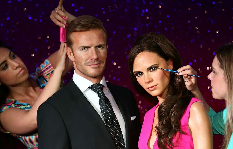 Almost lifelike:Finishing touches are applied to new wax figures of David and Victoria Beckham at Madame Tussauds in London. Photo: Tim P. Whitby, Getty Images
