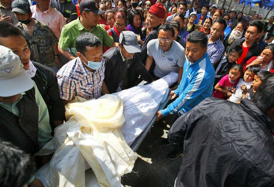 Men carry the body of Ang Kaji Sherpa, a guide killed in an avalanche on Mount Everest in April. Photo: Niranjan Shrestha, Associated Press