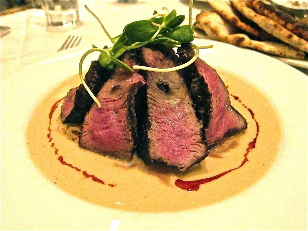 Indika Cuisine: IndianDish: kalonji-seed-crusted grass-fed beef filetEntree price: $$Where: 516 Westheimer RoadPhone: 713-524-2170Website: indikausa.com