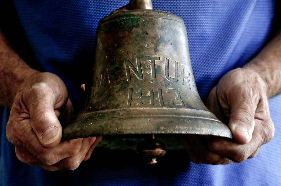 Mike Lemos, above, holds the bell from the schooner Adventuress, which was given to his father, Nick, below, in 1936. The ship's bell vanished after a fire a century ago. Photo: Michael Macor, The Chronicle