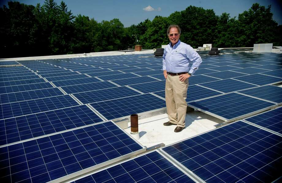 Sylvan Pomerantz, President of Temple Beth El in Stamford, poses for a photo among new solar panels installed on the temple's roof on Tuesday, July 16, 2013. The temple has been named this year's Renewable Role Model Winner by Interfaith Power and Light. Photo: Lindsay Perry / Stamford Advocate