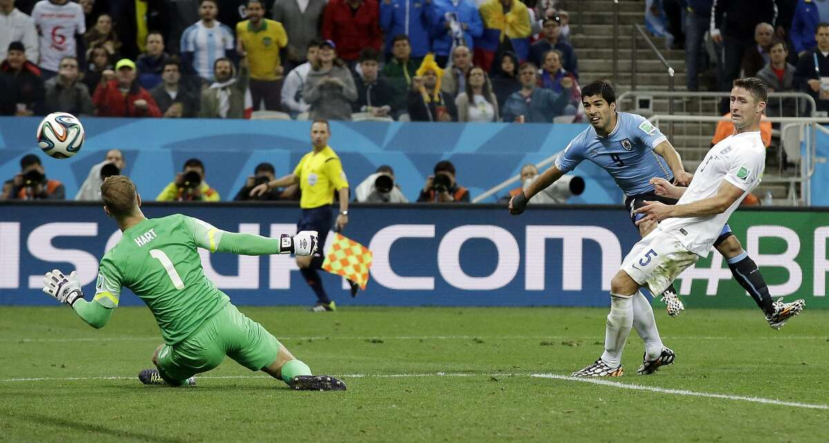 Uruguay's Luis Suarez scores his side's second goal during the group D World Cup soccer match between Uruguay and England at the Itaquerao Stadium in Sao Paulo, Brazil, Thursday, June 19, 2014. (AP Photo/Matt Dunham)