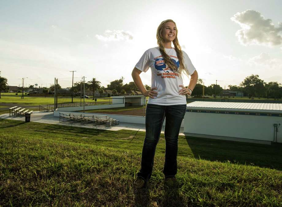 Angelina College sophomore and softball players Gia Johns poses for a photo near the Lamar State College-Port Arthur Seahawks softball field on Thursday afternoon.  Photo taken Thursday 6/19/14 Jake Daniels/@JakeD_in_SETX Photo: Jake Daniels / ©2014 The Beaumont Enterprise/Jake Daniels