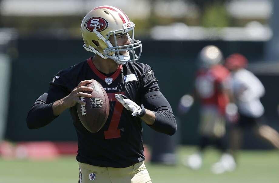 San Francisco 49ers quarterback Colin Kaepernick passes during NFL football minicamp in Santa Clara, Calif., Thursday, June 19, 2014. (AP Photo/Jeff Chiu) Photo: Associated Press