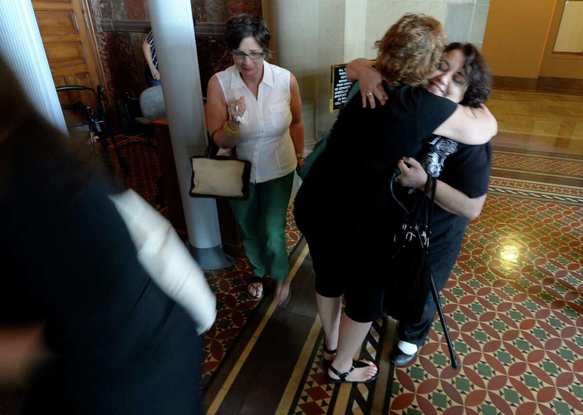 Medical marijuana advocates hug and share cry Friday afternoon, June 20, 2014, after the Medical Marijuana bill passed by the State Senate at the Capitol in Albany, N.Y. (Skip Dickstein / Times Union)