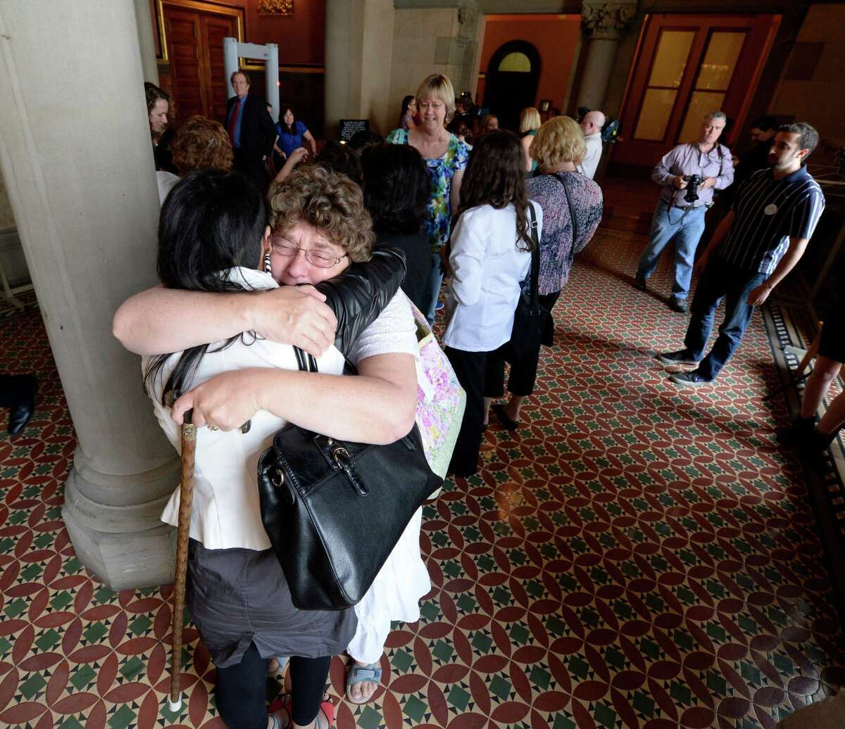 Medical marijuana advocates, Anna Saini of Brooklyn, left, and Caroline Vickery of Phoenix, N.Y., hug and share cry Friday afternoon, June 20, 2014, after the Medical Marijuana bill passed by the State Senate at the Capitol in Albany, N.Y. (Skip Dickstein / Times Union)