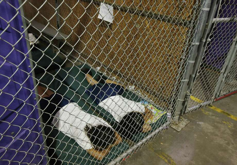 Detainees sleep in a holding cell in Nogales, Arizona. Thousands of mostly Central American immigrant children are being held at customs centers.  A reader says the U.S. should show compassion to these children. Photo: Ross D. Franklin / Associated Press / POOL AP
