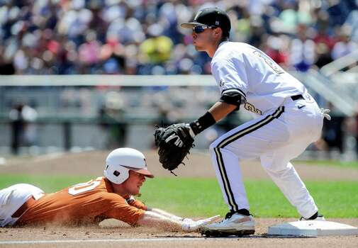 Texas' Zane Gurwitz, left, reaches third base on a triple against Vanderbilt third baseman Tyler Campbell (2) in the inning of an NCAA baseball College World Series game in Omaha, Neb., Friday, June 20, 2014. (AP Photo/Eric Francis) Photo: Eric Francis, Associated Press / FR9944 AP