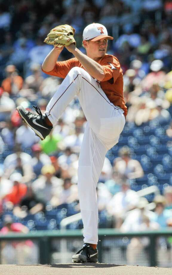 Texas starting pitcher Nathan Thornhill works against Vanderbilt in the first inning of an NCAA College World Series baseball game in Omaha, Neb., Friday, June 20, 2014. (AP Photo/Eric Francis) Photo: Eric Francis, Associated Press / FR9944 AP