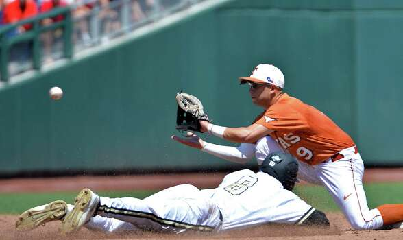 Vanderbilt's Rhett Wiseman (8) is caught stealing second base as Texas shortstop C.J Hinojosa (9) fields the throw in time during  the second inning of an NCAA College World Series baseball game in Omaha, Neb., Friday, June 20, 2014. (AP Photo/Ted Kirk) Photo: Ted Kirk, Associated Press / FR34398 AP