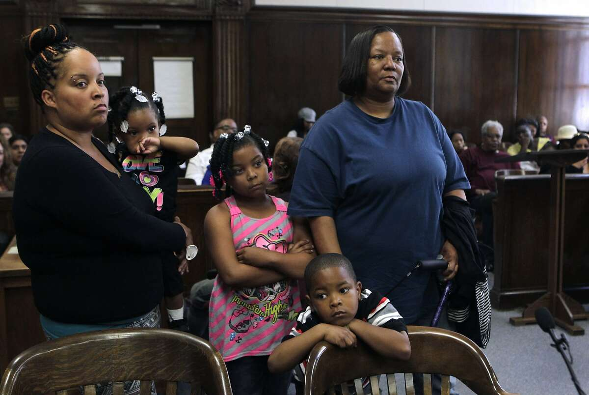 Anita Irving (left) and her family, including mother Anita Lester (right), appears before Judge Gloria Rhynes to have Irving's truancy case involving daughter Marianah Lee (center) dismissed at the Alameda County courthouse in Oakland, Calif. on Friday, June 20, 2014, after the family completed the District Attorney's truancy and attendance program.