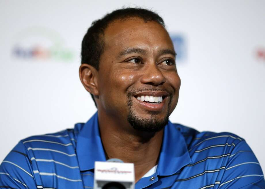 Golfer Tiger Woods speaks at a Quicken Loans National PGA tournament media day news conference at Congressional Country Club, Monday, May 19, 2014, in Bethesda, Md. Woods said his back injury was so debilitating that it caused him to doubt whether he would play golf again. While the surgery he had March 31 erased those doubts, he still has no timetable for his return. (AP Photo/Patrick Semansky) Photo: Patrick Semansky, Associated Press